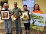 """First place, """"Vincent"""" (pastel) by Richard Ray; Second place, """"Sitting"""" (holly wood carving) by Matt Monahan; Third Place, """"Flower & Jug"""" (watercolor) by Carey Winberry; Honorable Mention, untitled (oil) by Ester Wyman"""